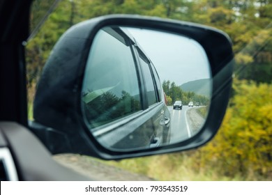 side rear-view mirror, autumn road at the car side mirror