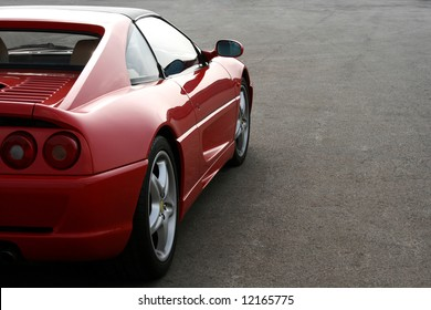 side of red ferrari F355 as the sun goes in