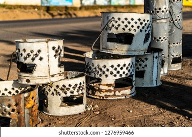 at the side of the road in Lusaka you can buy many heaters made from oil drums.