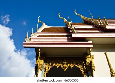 Side and roof of Buddhist temple with blue sky