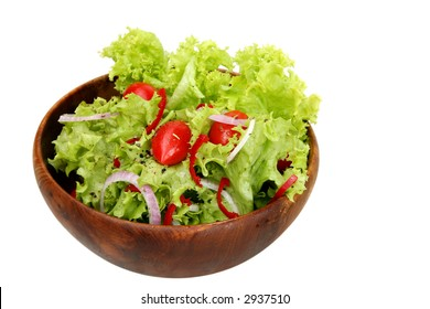 A side salad of curly coral lettuce, tiny grape tomatoes, spanish onions and chili, with a balsamic dressing.