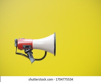Side shot of megaphone against yellow background