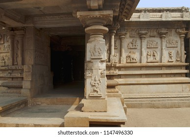 The side, south, porch of the ardhamandapa and the bas-reliefs on the outer wall depicting the scenes from the Ramayana. Hazara Rama Temple