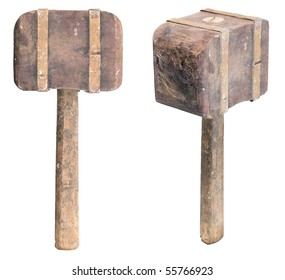 Side and tilt view of a dirty, aged wooden mallet or sledgehammer, isolated. Clipping paths are included