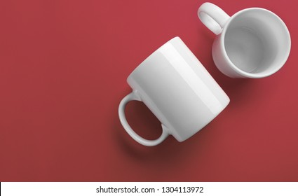 Side and top of white mugs view on coral color background