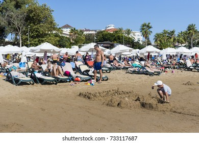 SIDE, TURKEY - 4 OCTOBER, 2017: Coast of Side in Turkey beaches of hotels with resting tourists