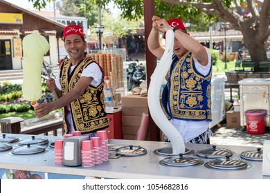 SIDE, TURKEY - april 19, 2012: Turkish men in turk costumes  selling traditional turkish icecream on a street in Side, Turkey