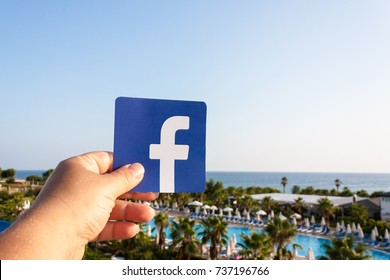 Side, Turkey. August, 2017. Printed logo of the famous social network Facebook. Palm trees and sea are on the background. Concept. The beach, the sky.