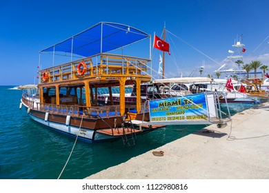 Side, Turkey - June 8, 2018: Fishing boats in the harbor of Side, Turkey. Side  is an ancient Greek city on the southern Mediterranean coast of Turkey.