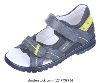 Side upper view of blue and yellow leather and suede boy sandal with slits and slots, perforated insole and two velcros, isolated on white