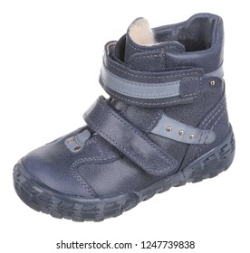 Side upper view of dark blue and gray leather water resistant winter insulated male high boot with velcro clasps, metal elements and artificial fur insulation, isolated on white