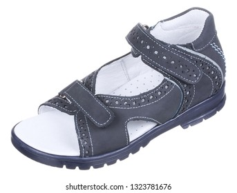 Side upper view of dark blue and white suede boy sandal with perforation, slits and slots, and two velcros, isolated on white