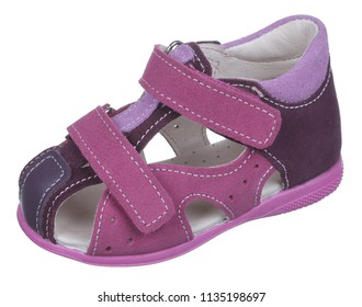 Side upper view of rose, violet, purple, brown and white suede and leather girl sandal with slits and slots and two velcros, isolated on white