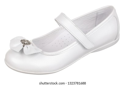 Side upper view of white leather girl low shoe with bow-knot and velcro, isolated on white