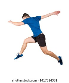 Side vie full length of determined man athlete jumping over imaginary obstacle isolated over white background. Young guy runner in sportswear makes sprint for leap over chasm.