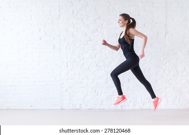 Side view of active sporty young running woman runner athlete with copy space concept sport health fitness loss weight cardio training jog workout wellness.