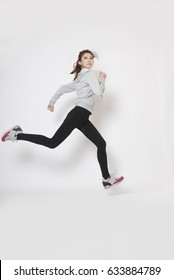 Side view of active sporty young running woman runner.