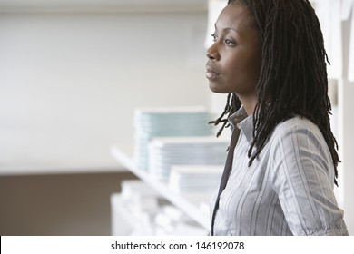 Side view of an African American businesswoman looking away in office