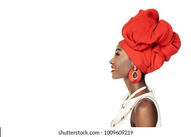 side view of african american woman in ethnic accessories  isolated on white