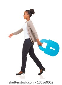 side view of african american woman walking with lock symbol on white background