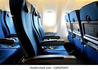 Side View of Airplane's Blue Seats.