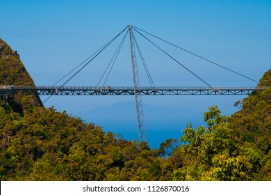 Side view of the amazing Langkawi Sky Bridge, a curved pedestrian cable-stayed bridge, suspended by cables from a single pylon, connecting two hilltops at Gunung Mat Chinchang on Langkawi, Malaysia.