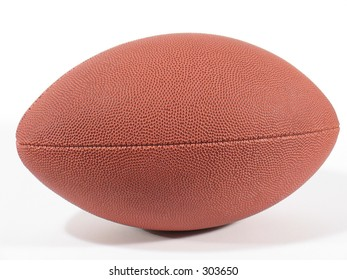 Side view of an American football on white background