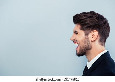 Side view of angry businessman with big problems screaming