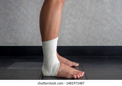 Side view of an Ankle tape job on an athlete's ankle