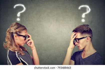 Side view of anxious man and woman having difficulties in marriage looking perplexed.