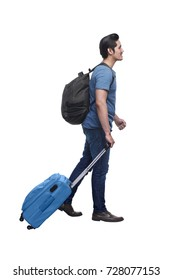 Side view of asian traveler man holding suitcase posing isolated over white background