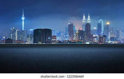 Side view asphalt road on night , Kuala Lumpur city .