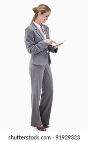 Side view of bank employee using tablet against a white background