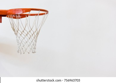 Side view of the basketball hoop with slightly shadow on a wall.