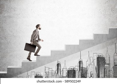 Side view of a bearded man carrying a suitcase and going up the stairs. There is a city sketch on a concrete wall. Mock up