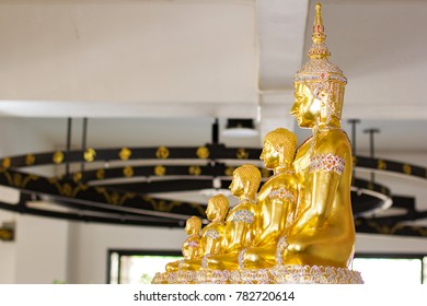 Side view of beautiful five gold buddhas statue.