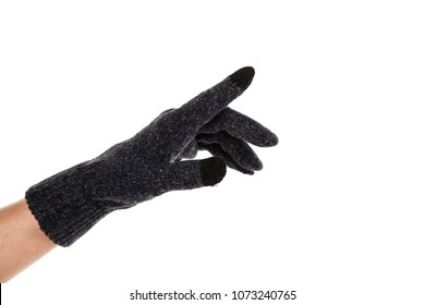 Side view of beautiful human hand palm dressed in new nice and soft natural wool fabric touch screen gloves isolated on abstract white background. Wearing and special clothes concept. Detailed closeup