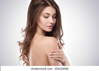 Side view of beautiful natural woman
