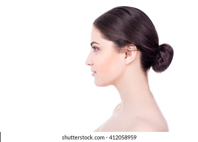 side view of beautiful woman with perfect skin isolated on white background