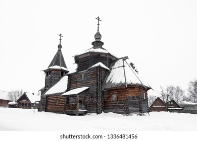 Side view of a beautiful wooden church in the snow