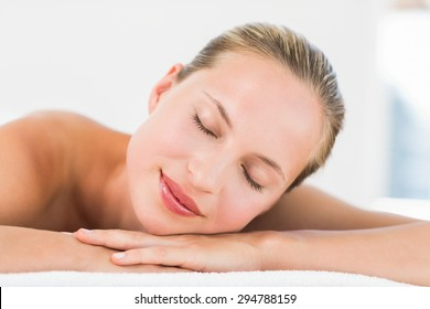 Side view of a beautiful young woman on massage table at health farm