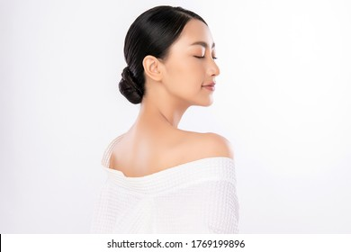Side view of Beauty Woman face Portrait, Beautiful Young Asian Woman with Clean Fresh Healthy Skin, Facial treatment. Cosmetology, beauty and spa, isolated on white background.