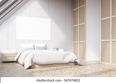 Side view of a bedroom in the attic with a large horizontal poster situated above the master bed. Wooden floor. 3d rendering. Mock up.