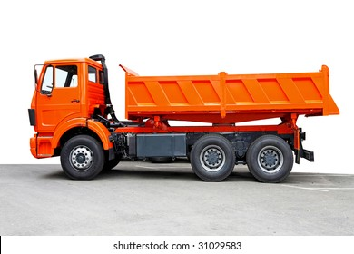 Side view of big orange truck tipper