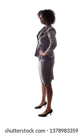 Side View of Black Businesswoman posing as a confident leader or arrogant person.  She is isolated on a white background