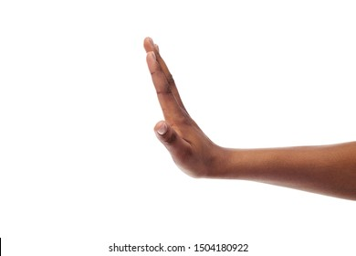 Side view of black female hand showing stop gesture, isolated on white background, copy space