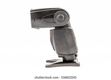 Side view of a black unbranded external flash unit for DSLR camera