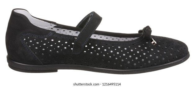 Side view of black and white perforated women's suede shoe with velcro and bow, isolated on white