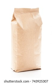 Side view of blank paper bag for tea, coffee and grain packaging. Retail shopping and advertising concept. Isolated on a white background. Detailed closeup studio shot