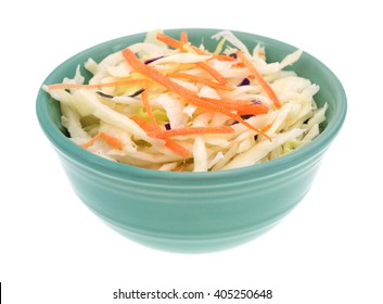 Side view of a bowl filled with coleslaw isolated on a white background.